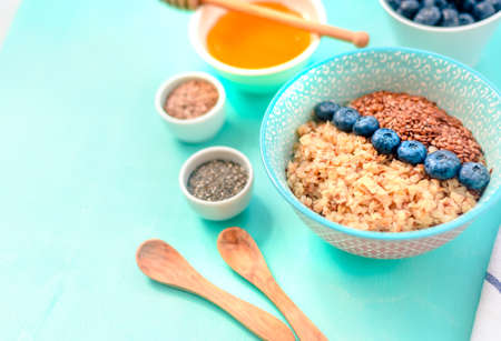 Buckwheat porridge in a bowl with flax seeds and blueberries. oncept healthy food, detox, diet Stock Photo - 118403721