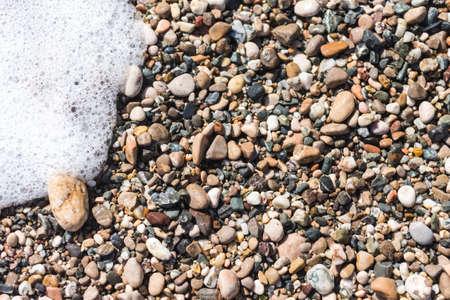 sea stones background pattern and Sea foam Archivio Fotografico - 119718877