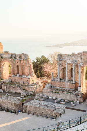 Greek reatre in Taormina Sicily, Italy, and Etna volcano in the background