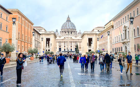 Vatican, Rome, St. Peters Basilica, November 24, 2018, typical roman day, tourists walk near St. Peters Cathedral