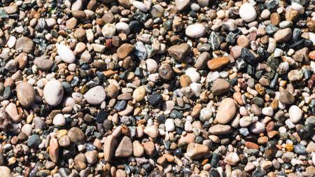 Sea pebble, stones  beach rocks and Sea foam
