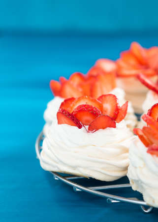 Beautiful pavlova cakes with strawberries. Selective focus. Tasty sweet breackfast. Wedding morning. Meringue with cream.