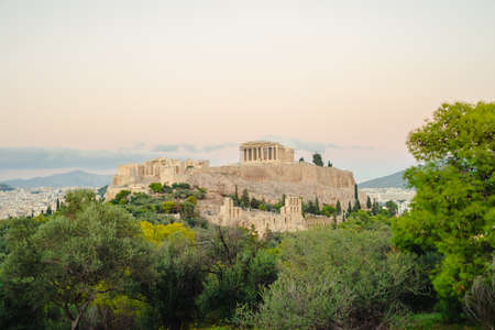 Acropolis with Parthenon. View through ancient marbles and cityscape, Athens, Greece. Stock Photo