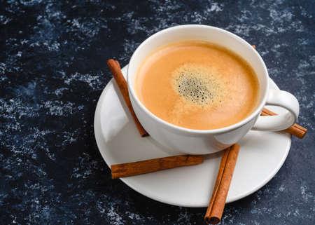 Vintage latte coffee with cinnamon