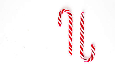 Candy canes on a white surface, top view Stockfoto - 127508423
