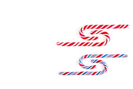 Candy canes on a white surface, top view Stockfoto - 127508426