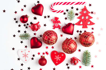 Flat lay Christmas composition with holiday ornament on white background. Top view. Stockfoto - 127508428