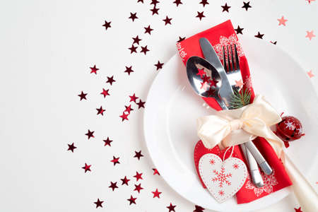 Christmas table place setting. Holidays background, top view Stockfoto - 127508430