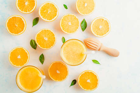 Fresh Orange juice smoothie in glass and fresh citrus around. Healthy drink on white. Top view. Stockfoto - 127508739