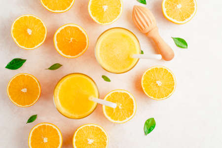 Fresh Orange juice smoothie in glass and fresh citrus around. Healthy drink on white. Top view. Stockfoto - 127508740