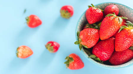 fresh Strawberry in a bowl top view blue background
