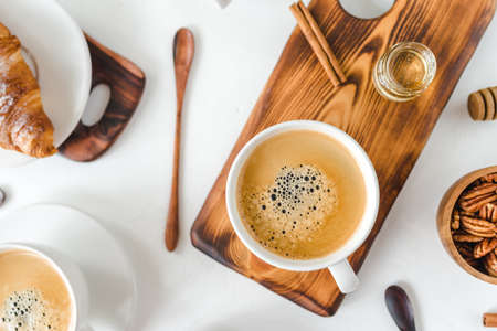 Breakfast with coffee and croissants on wooden table Stockfoto - 128261260