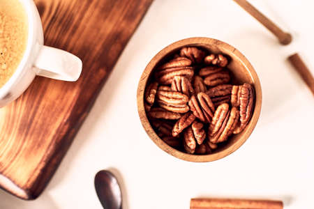 A bunch of peeled pecans on a white, isolated.
