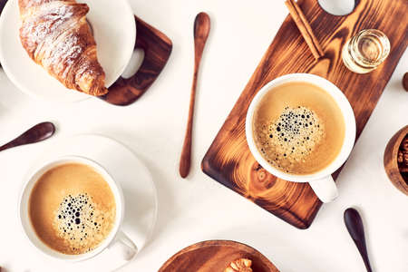 Perfect breakfast of croissant and coffee on wooden table. Stock fotó