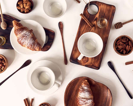 Perfect breakfast of croissant and coffee on wooden table. Rustic style. Top view. Stock fotó - 129843873