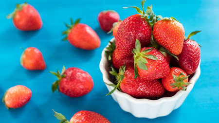 Fresh Strawberry in a bowl top view blue