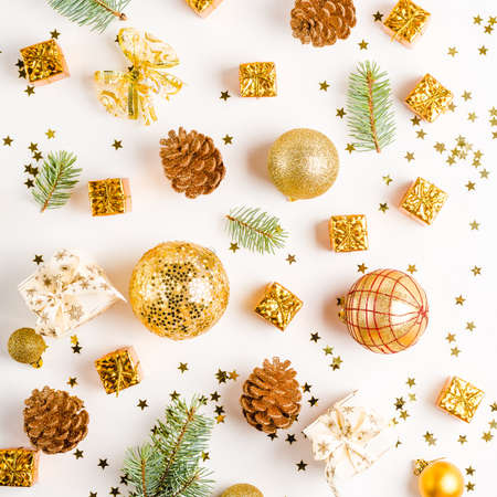 Christmas composition. Christmas balls, golden decorations on white Stock Photo