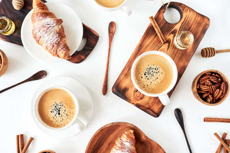 Perfect breakfast of croissant and coffee on wooden table. Stock fotó - 129843399
