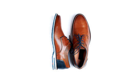 Male brown leather shoes isolated on a white, top view