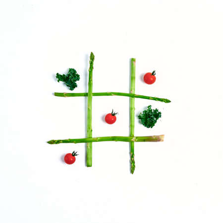Tic tac toe with food, asparagus kale, tomato, concept slimming, decision, choice victory