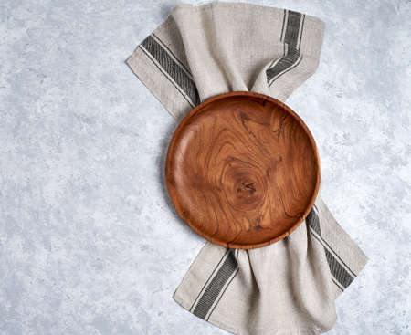 Tablecloth, wooden plate on blue and white table Stock Photo