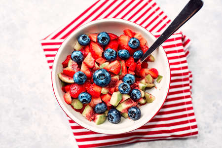 Bowl of fruit salad fig strawberry blueberry, concept diet and healthy eating Stock Photo