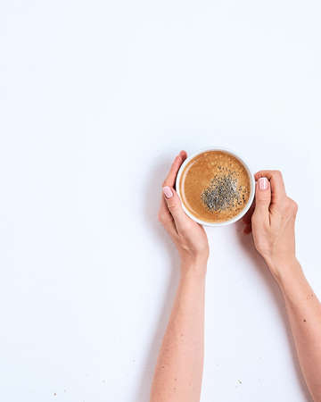 Coffee cup in female hands on a white Stockfoto