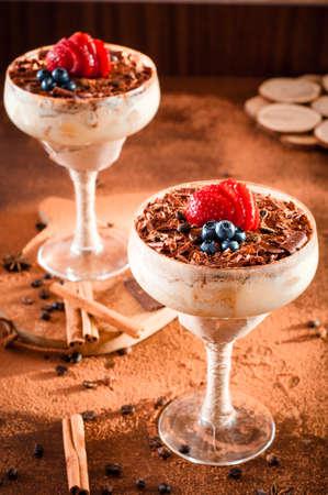 Italian dessert tiramisu with strawberry in an elegant cocktail glass Stock Photo