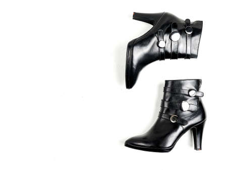 Black autumn heeled boots with silver rivets, top view,
