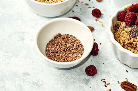 Raw flax seeds in a ceramic cup on the table. Stok Fotoğraf