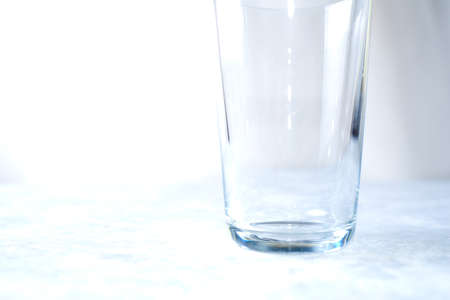 Empty glass isolated on a blue background close up