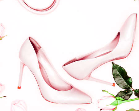 Pale pink female shoes on white background. Flat lay, top view trendy fashion feminine background. 写真素材