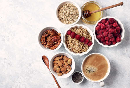 healthy oatmeal breakfast with raspberries and finns, chia and flax seeds, pattern, top visas, good morning concept