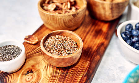 bowl with flax seeds, on a kitchen cutting board, diet, healthy lifestyle