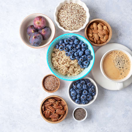 Ingredients for a healthy breakfast, quinoa with blueberry, fig, honey and nuts. Concept healthy eating.