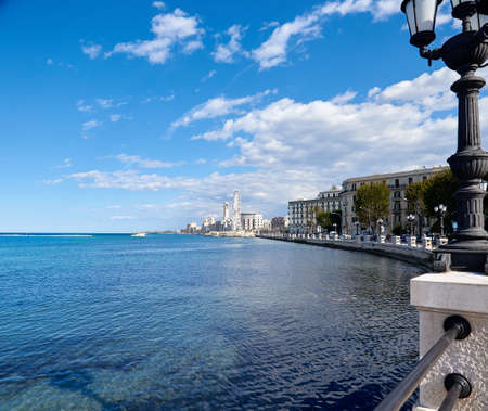 Panorama of the Italian city of Bari, promenade, lights, observation wheel, spring. Traveling in Italy, tourism