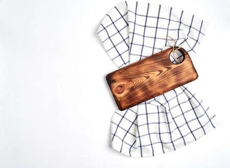kitchen cloth napkin and kitchen board on white background