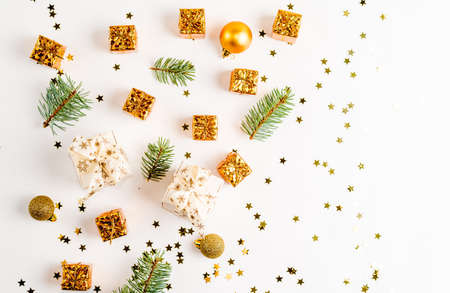 Christmas composition. Christmas golden decorations, pine cone, star, balls on white background. Flat lay, top view, copy space Stok Fotoğraf