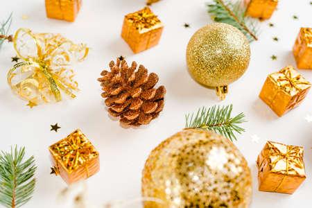 Christmas composition. Christmas balls, golden decorations on white Stok Fotoğraf