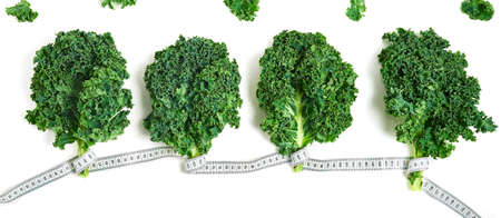 creative layout kale with measuring tape concept diet, healthy lifestyle, diet, vegetarian, top view.