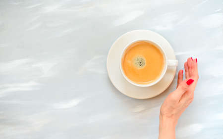 cup of coffee, top view gray background, good morning concept
