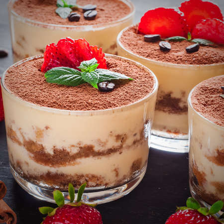 Strawberry dessert tiramisu on a brown background Stok Fotoğraf
