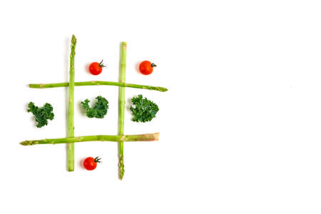 Tic tac toe with food, asparagus kale, tomato, concept slimming