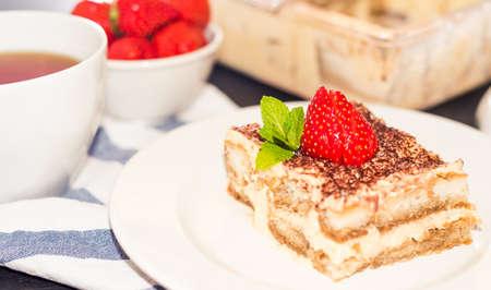 Gourmet tiramisu dessert with strawberries in a beautiful plate