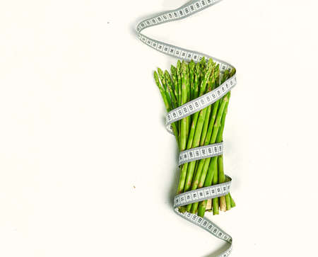 Creative layout asparagus with measuring tape concept diet Stock fotó - 133831192