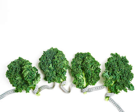 Kale wrapped in measuring tape, concept diet, slimming, healthy eating top view Stock fotó - 133831196