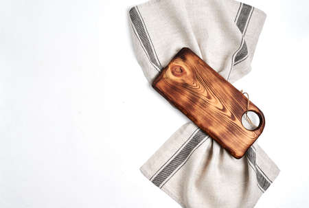 Beautiful wooden kitchen  cutting board over kitchen towel on white Stock fotó - 133831195