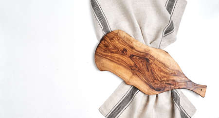 Beautiful wooden kitchen  cutting board over kitchen towel on white Stock fotó - 133831199