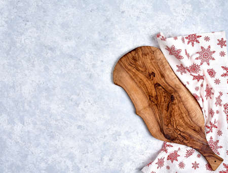 Empty kitchen cutting board with red christmas tablecloth. Stock fotó - 133831206