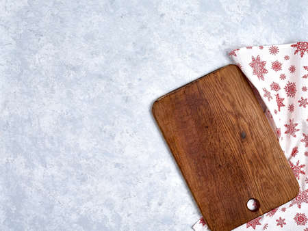 Empty kitchen cutting board with red christmas tablecloth. Stock fotó - 133831682
